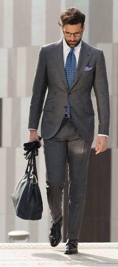 Charcoal grey windowpane suit, black leather gloves, black leather bag, light blue madder tie, lavender purple p square, white shirt