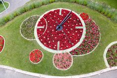 Geneva, Switzerland -- Flower Clock -- Horloge fleurie dans des tons rouges