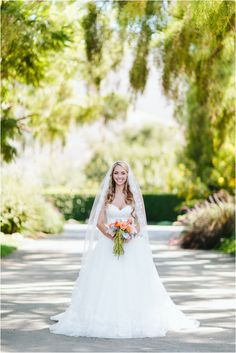 Maravilla Gardens Wedding by Ashleigh Jayne Photography with a traditional sweetheart neckline dress with a-line from the hip skirt and long veil