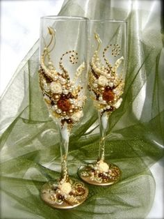 Beautiful pair of wedding champagne flutes are hand decorated with fabric roses and pearls in gold, ivory and chocolate brown. It's a by Janny Dangerous
