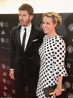 Manchester United and England midfielder Michael Carrick poses as he arrives at the end-of-season awards do with his wife Lisa