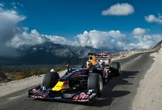 Watch this #RedBull racing car take on one of the highest roads in the World. Click for death defying action!