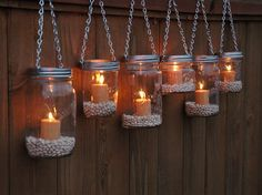 Mason Jar Lanterns Hanging Tea Light Luminaries - Set of 6 - Silver Chain - Wide Mouth Mason Jar Style. $38.00, via Etsy.
