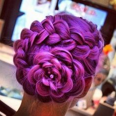 purple and pink flower French braid updo