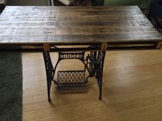Pallet desk with singer sewing machine base, which dates to early 1900's.