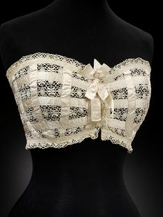 Bust Improver - c. 1910 - Dickins & Jones (retailer) - Lace and ribbon, mother-of-pearl - Made in United Kingdom