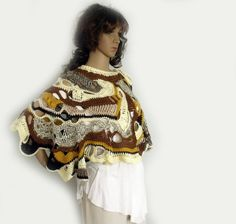 Freeform crochet cape, Crochet poncho, Boho shawl, Crochet stole, Gypsy capelet, Freeform poncho, Trend fashion, Wearable art. Freeform crochet capelet / stole / poncho is warm, soft, cozy, and unique accessory that will keep you comfy and stylish. The colors are different shades of brown, cocoa, yellow, and cream. These earthy colors are very autumnal. The freeform crochet pattern makes the texture rich and the piece attractive. The shape of this capelet is a circle with asymmetrical…