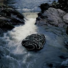 Andy Goldsworthy, Enclosure — when wet or frozen wool festooning a grey landscape.