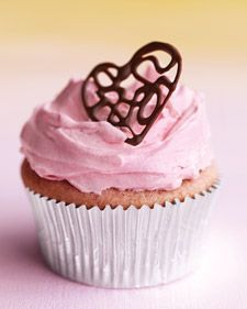 Rasberry Cupcakes with pink buttercream and lacy chocolate hearts...to make the hearts, see the Chocolate Filigree Hearts how-to.