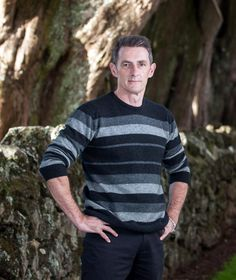 A modern mix of charcoal and silver grey striped mens sweater in possum merino wool which is soft and warm. This is perfect for smart casual weekend wear and a wonderful gift for a man. NZD$210