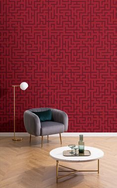 Make a statement with your interior style in an opulent way with this Red Geometric Labyrinth Pattern Wallpaper Mural, a deep and luxurious toned wallpaper that's perfect for modern homes. The bespoke pattern takes inspiration from the iconic Art Deco Style, with a detailed labyrinth style pattern that captivates the eye in an intriguing way.