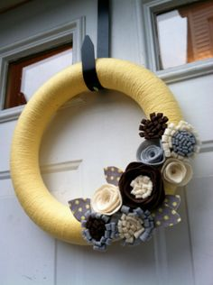 Yellow Yarn Wreath with Felt Flowers. Great for the summer.. $38.00, via Etsy.
