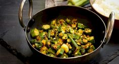 The origin of okra (ladyfinger plant) is disputed where some believe it is from Asia and supporters claim it to be from Egypt #Bhindi #ladyfinger #ladyfingersokra #bhindimasala #okra #bhindicurry #CrispyIndianOkra #maasbest #tiffinserviceinslough #Bhindiracipieinslough #foodserviceinburnhum Indian Food Recipes, Vegetarian Recipes, Ethnic Recipes, Tiffin Service, Masala Curry, Aloo Gobi, Lamb Curry, Famous Recipe, Saag