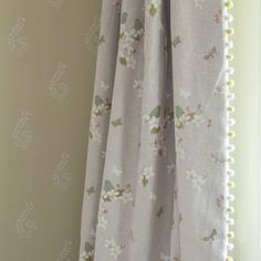 Large Shalini wallpaper printed in our delicate Moonlight colour with Ivory pattern. Designed to complement and mix and match with our paint and fabric collections. Printed in the UK. £52 per roll. Apple Blossom curtains in Ivory/Duck Egg