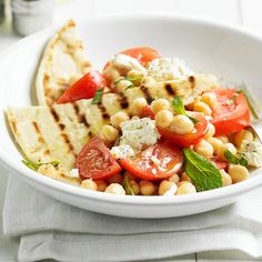 This Chickpea Salad with Grilled Pita is full of all your favorite Mediterranean ingredients! More 20-minute dinners: http://www.bhg.com/recipes/quick-easy/dinners-30-minutes-less/20-minute-dinners/?socsrc=bhgpin091313chickpeasalad#page=7