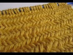 Herringbone stitch:  (For a border, knit 2 to 4 rows, then when you're ready to start the herringbone stitch, knit the first and last 3 stitches of every row. When you scarf is to your desired length, knit 2-4 rows and then bind off.)