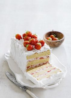 The best recipe for strawberry layer cake. This dinner-party dessert is made with vanilla sponge, filled with strawberry mascarpone cream with Italian meringue frosting.