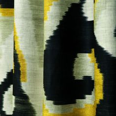 ARTWORK by Dedar - A print of bold multicoloured brushstrokes on a linen ground and a large-scale ikat pattern of central asian inspiration accentuate the marvellous pictorial effect of this fabric.