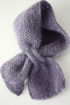 Baby scarf - safest design loops one side through the other.