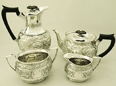 A fine and impressive antique Victorian English sterling silver four piece tea and coffee service / set; part of our silver teaware collection  http://www.acsilver.co.uk/shop/pc/Sterling-Silver-Four-Piece-Tea-and-Coffee-Service-Boxed-Antique-Victorian-97p3067.htm