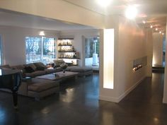 living room with an l shapped grey couch and black tiles on the floor - Salon Avec Canape Noir