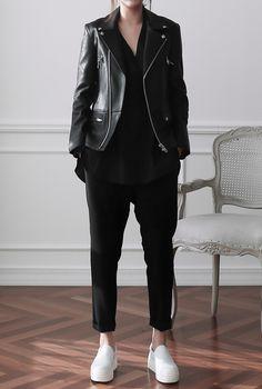 Black leather jacket, black shirt, black pants, white sneakers