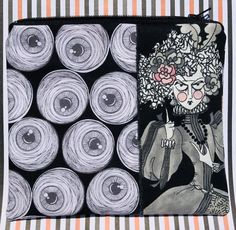 Hello! Thank you for visiting my shop. <3 Please know that this item was handmade by me on my sewing machine (not in a factory!). This one of a kind zipper pouch was made using spooky eyeballs fabric. I added an appliqué featuring Mathilde Ghastlie of The Ghastlies by Alexander Henry. I gave the