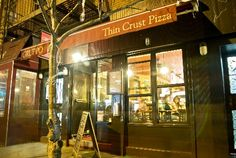 gruppos thin crust pizza on ave b between 11th and 12th
