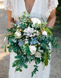 Unique wedding bouquet ideas and inspiration. Wedding bouquet with succulents and lots of greenery.
