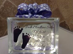 """SPECIAL ORDER """"BABY FOOT PRINT"""" WITH BABY'S DETAILS, LASER ETCHED IN WITH PURPLE POLKA DOT RIBBON EMBELLISHMENT AND WARM LED BATTERY OPERATED LIGHTS. Laser etching by Lavene & Co"""
