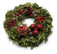 Wreaths can be adapted to decorate for all occasions and seasons. An autumn wreath could showcase the beauty of fall foliage, while a winter wreath could feature evergreens and deep colored ribbons, berries and winter blossoms. A spring wreaths might be covered with new buds and fresh herbs, while a summer wreaths could burst with greenery. Wreaths can be expensive, but you don't have to drop a bundle on them, as they are fairly easy and inexpensive to make.