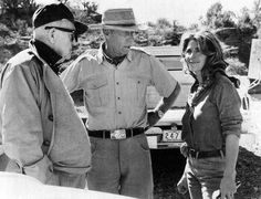 John Ford visits with director Howard Hawks and Michele Carey between takes on the set of El Dorado, 1966