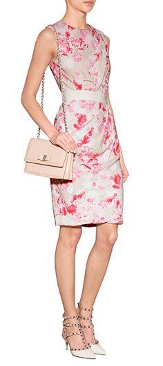 A pretty diagonal drape lends understated elegance to this pretty floral print sheath dress from Giambattista Valli #Stylebop