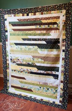 Jelly Roll Race, Louann has to see this! I do like this black and ... : size of jelly roll race quilt - Adamdwight.com