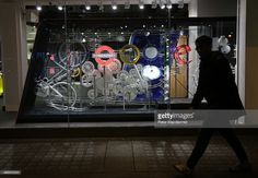 A display representing the Google name and logo is lit up at night in the window of a branch of PC World on March 16, 2015 in London, England. Google's new shop is selling Chromebook laptops, Android phones, tablets and Chromecast TV devices.