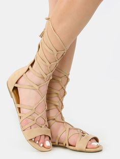 Lace it up in the Lace Up Tassel Gladiator Sandals! Features an open toe, faux suede upper, back zipper, and lace up design.