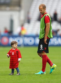 Migjen Basha of Albania and his child are seen after the UEFA EURO 2016 Group A match between Albania and Switzerland at Stade Bollaert-Delelis on June 11, 2016 in Lens, France.