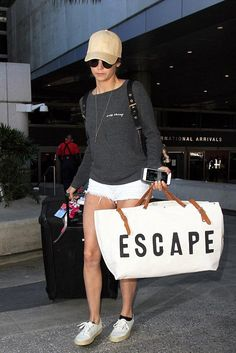 Nina Dobrev wearing Forestbound Escape Canvas Utility Bag, Vix Straw Baseball Cap, Superga Coti 2750 Espadrille Sneakers and Burberry Nylon Backpack