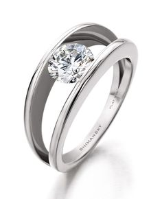 Millenium Diamond Ring by Shimansky (South African company) This is what I want. This one!