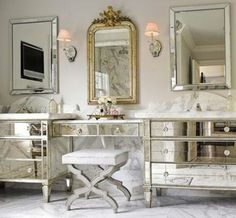 This vintage mirror adds pizzaz to this hollywood regency bathroom.