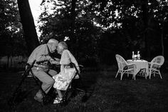 Norbert & Mary have enjoyed romantic summer dinners in their backyard for the last 70 years. Both in their 90's; they celebrated their 70th wedding anniversary this past year. Both require assistance to stand so they cuddled in their walkers.