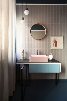 Subway tiles, verticaly placed, stone colour, retro styling. light pink wash basin! loving the geometry. Retro is back and its here to stay!