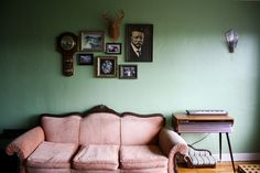 I am officially in love with the mint green wall/pink vintage sofa combination.