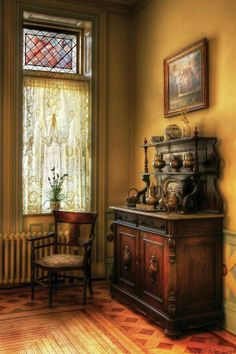 Captures the Victorian feeling quite perfectly. Antique style, Victorian interior. Beautiful cabinet, server, display, etagere.