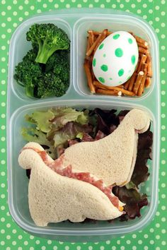 Make sandwichs and cut out with dinosaur cookie cutter. The triangles of meat really make it cute.