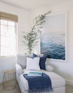 modern coastal family room with shiplap and modern ocean print chaise with blue and white decor seating area in coastal bedroom design Love the chaise the blanket color photo plant window coverings # Coastal Family Rooms, Coastal Bedrooms, Coastal Homes, Modern Bedroom, Contemporary Bedroom, Coastal Interior, Bedroom Small, Modern Interior, Bedroom Rustic