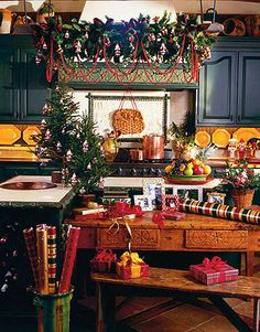 love the small trees and decorations above stove christmas kitchen decorations christmas decorating ideas - Country Style Christmas Decorations