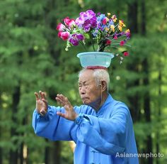 Tai Chi improves your balance! Especially when you buy flowers for your wife!