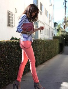 Neon skinny jeans and contrasting stripes done right with basic cognac accessories.