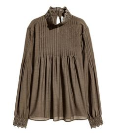 Check this out! Blouse in woven, cotton-blend fabric with a lace stand-up collar. Opening at back of neck with button, pin tucks at top and on the sleeves, and lace cuffs with buttons. Flare to hem. - Visit hm.com to see more.